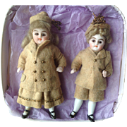 Pair of Factory Original 19thC all bisque dolls