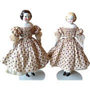 SOLD Pair of 1860s China/ Parian dolls house dolls in original clothing