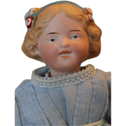 "Goebel  doll, 7"" tall, bisque smiling expression, character doll, German on small composi"