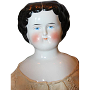"19"" tall German china head, flat top, molded curls with center part.  shoulderhead doll,"