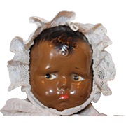 """11"""" tall, Black composition Effanbee  Baby Grumpy Doll. White baby gown and slip. arms ha"""