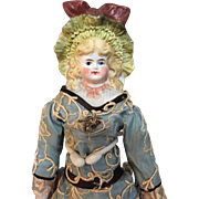 Glorious little Hertwig bonnet head doll in beautiful original costume .