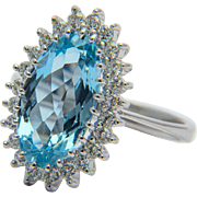 Vintage Aquamarine and diamonds ring circa 1970 white gold 18 k cluster ring engagement ring .