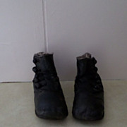 Antique Dolls or Baby Shoes