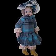 Antique Googly Eye Composition Girl Doll .
