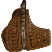 Carved slipper stirrup with intricate silver inlaid band