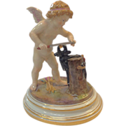 Meissen Cupid Blacksmith at Anvil