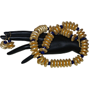 Artisan Created Hand Strung 22 Karat Gold Plated Disc Necklace with Faceted Sapphire Spacers .