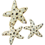 Signed Swarovski Starfish Brooch with Earrings.