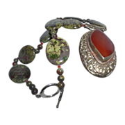 SALE Stunning Hand Strung Natural Australian Dragon Blood with a Carnelian Tibetan Pendant