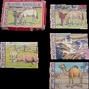 Set of 4 Sliced Animal Puzzles Including Original Box