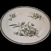 Seasons (Autumn) Platter: cartouches with sprays of grain, daisies, man harvesting grain