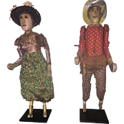 Pair of folk art dolls wood carved with clothing, American, c. 1920