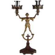 A Gothic Revival iron and bronze candelabrum of Till Eulenspiegel, probably German, circa 1865