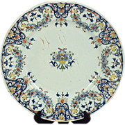A large early 18th century Rouen faience plate decorated in the 'style rayonnant', circa .