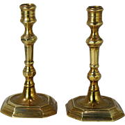 A pair of 17th century cast brass 'Huguenot' candlesticks, English or French, circa 1690