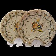 A pair of mid 18th century Talavera majolica scalloped shaped barber's bowls, Talavera de la