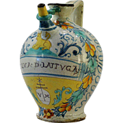 An early 17th century Italian polychrome majolica 'wet' or syrup drug jar dated 1620, ...