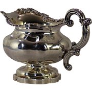 A fine early 19th century Russian Imperial cast silver gilt creamer, maker's mark for Adolf