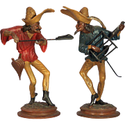 A pair of vintage mid-century candelabra depicting two dancing Commedia del'arte chefs, ...