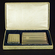 A handsome American Art Deco Nickel Silver Cigarette case and match safe together with the ...