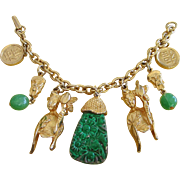 Oriental, Asian Themed Faux Carved Jade and Figural Charm Bracelet