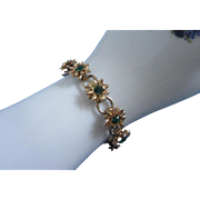 SALE Gold Tone Flower Bracelet with Emerald Green Rhinestones
