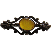 Arts and Crafts Sterling and Honey Amber Pin