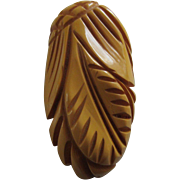 Deeply Carved Butterscotch Bakelite Clip - Pineapple and Leaves