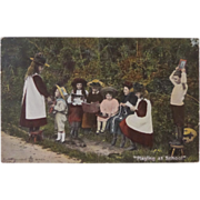Children 'Playing at School' Real Photo Postcard 1905