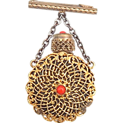 Vintage perfume bottle pin with coral stopper
