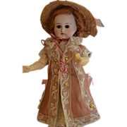 Beautiful german bisque little doll marked 112