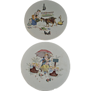Wonderful pair of Sarreguemines Plates with  colored scenes