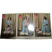 3 postcards with a girl and her Jumeau doll
