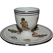 Nice 1930 egg cup for child decorated with child cat and toys