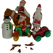 Vintage Santa wind-up cello friction toys LooK