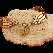 Vintage English 9 Karat Gold Gate Bracelet with Heart and Key Clasp