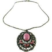 1930's Czechoslovakian Brass Pendant Necklace With Pink Glass Cabochon And Enameling
