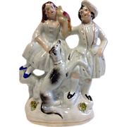 Victorian Staffordshire Figure-Couple with Bird and Whippet