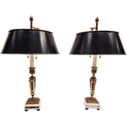 Pair of French bronze, glass, and marble candlestick lamps fitted with black tole shades