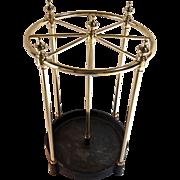 Round English umbrella stand with cast iron base