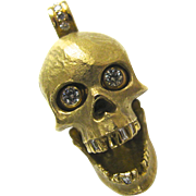 An Articulated 18K Gold and Diamond Skull Pendant
