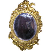 Victorian French gilded bronze vanity mirror with putties