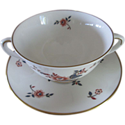 Footed cream soup bowl and saucer