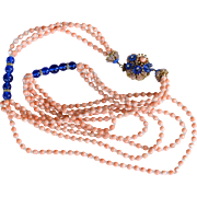 Vintage signed Stanley Hagler cobalt blue and coral colored glass bead necklace