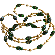 Vintage signed William de Lillo green glass & gold toned flapper length necklace