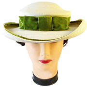 M. O'Neil cream straw hat with green bow