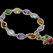 Vintage Aquamarine Amethyst Tourmaline Dangling Charm Bracelet 18K Gold Estate
