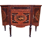 old commode made from fruit wood in Louis XVI style