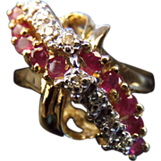 Stunning Estate Designer 14 Karat Yellow Gold .86 Carat Ruby and Diamond Waterfall Ring.